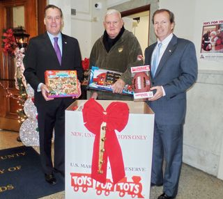 Register O'Donnell Delivers Donated Toys to Toys for Tots
